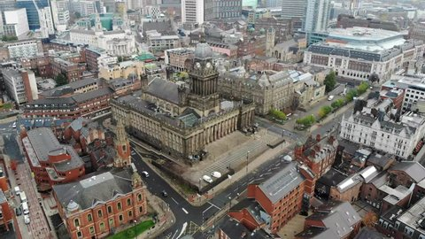 Leeds Town Hall aerial footage over looking the whole of the Leeds City Centre in West Yorkshire in the UK and showing the Leeds Town Hall historical building and  local businesses in the town.