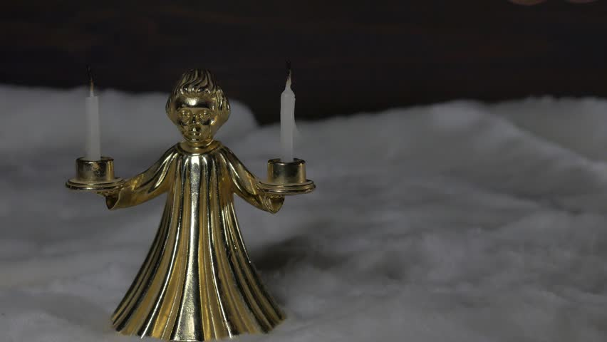 Golden candlestick angel with candles in their hands. | Shutterstock HD Video #1019648602