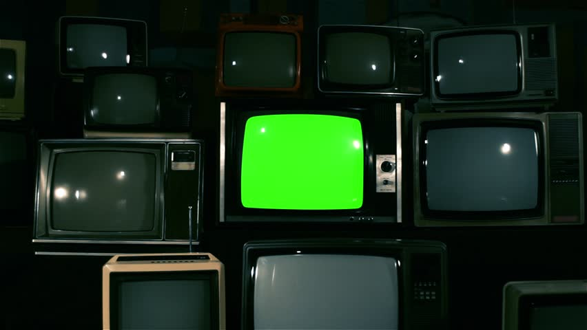 "80s TV Green Screen with Many 80s Tvs. Dolly In Fast. Blue Steel Tone. Ready to Replace Green Screen With any Footage or Picture you Want. You Can Do it With ""Keying"" (Chroma Key) Effect. 