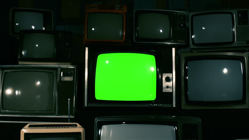 """80s TV Green Screen with Many 80s TVs. Dolly In Fast. Blue Steel Tone. Ready to Replace Green Screen With any Footage or Picture you Want. You Can Do it With """"Keying"""" (Chroma Key) Effect. 