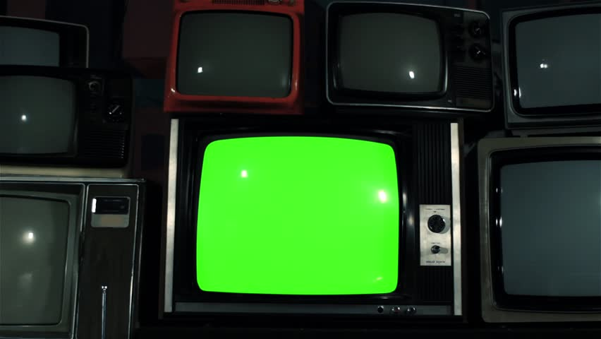 "Old TV Green Screen over 80s TVs. Dolly Out. Iron Tone. You can Replace Green Screen with the Footage or Picture you Want with ""Keying"" effect in After Effects (check out tutorials on YouTube).  