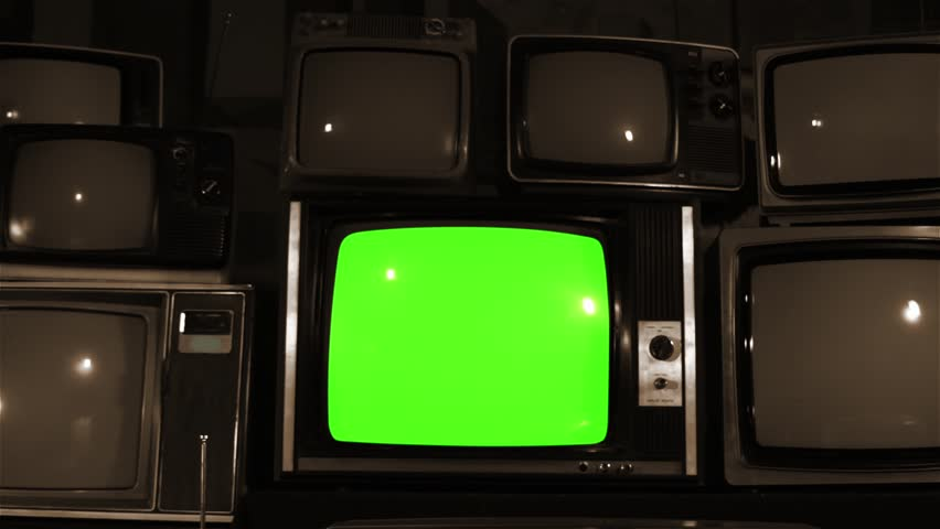 "80s TV Green Screen with Many 80s Tvs. Dolly Out Fast. Sepia Tone. Ready to Replace Green Screen With any Footage or Picture you Want. You Can Do it With ""Keying"" (Chroma Key) Effect. 