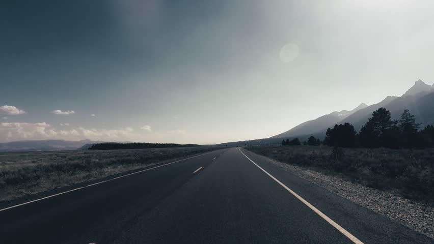 Driving a Car through Grand Teton park, back light, Point of View - Mounted 2.7k Ultra HD footage   Shutterstock HD Video #1019720992