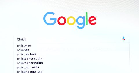 """Paris, France - November 20, 2018: Google Search Engine Search For Word """"Christmas"""" In Google's Search Bar. Google.com Homepage. Close Up View Of A Computer Monitor Screen - DCi 4K Resolution"""