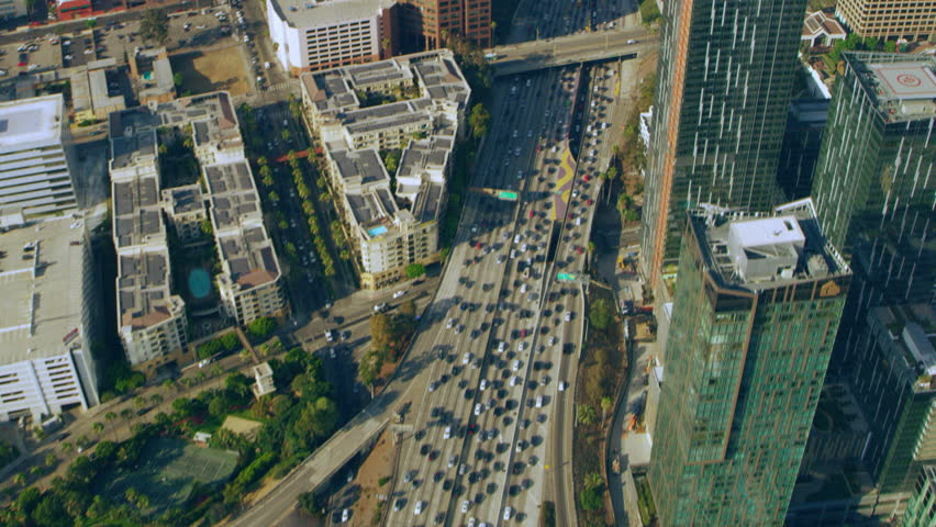Los Angeles, California CIRCA - 2018. Aerial view of downtown LA traffic on the freeway on a sunny day in Los Angeles, California. Shot on 4K RED camera.