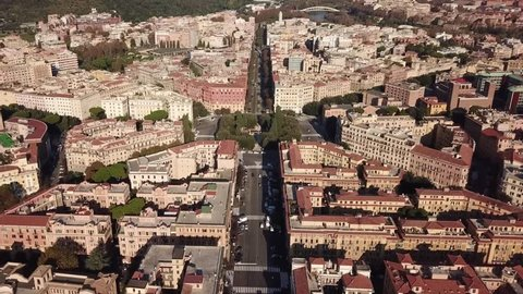 Aerial drone bird's eye panoramic view video of iconic Mazzini square and fountain in the heart of Prati district, Rome, Italy