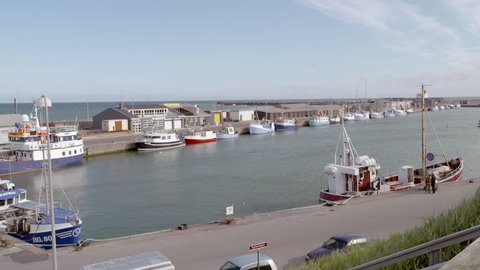 Small colorfull fishing boats in Danish harbour. Romantic small ships, sunny day.