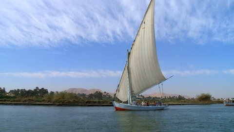 View of sailboats crossing Nile River / Luxor, Egypt