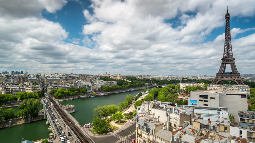 PARIS, FRANCE - JUNE 19, 2018: Eiffel Tower day timelapse. Fast movement. Sunny day with clouds. 4K shot | Shutterstock HD Video #1019921452