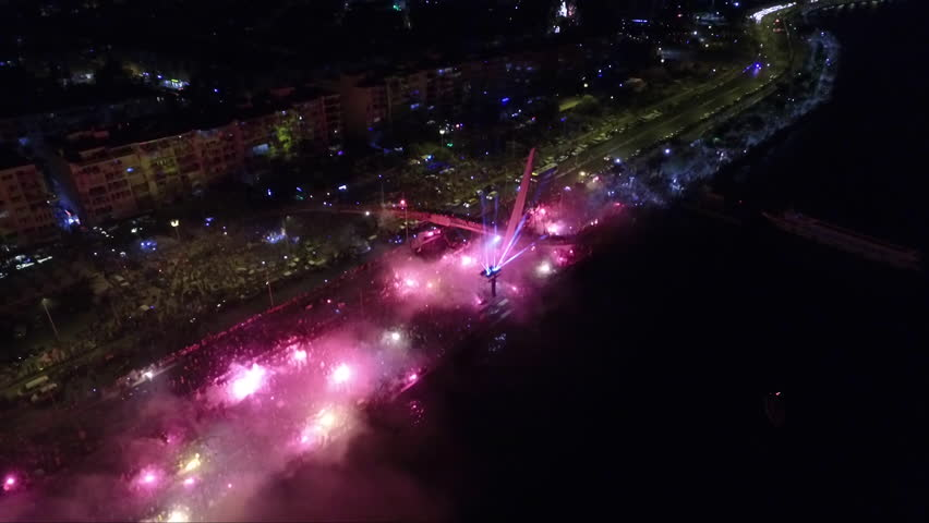Celebration by burning torch by the sea   Shutterstock HD Video #1019976352