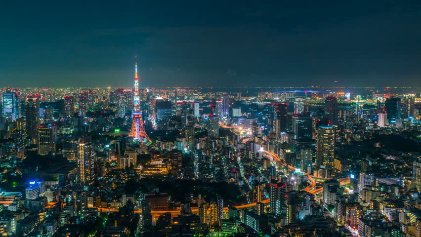 Timelapse with zoom in motion of iconic Tokyo Tower in vast sea of city lights in Tokyo, Japan | Shutterstock HD Video #1020043672