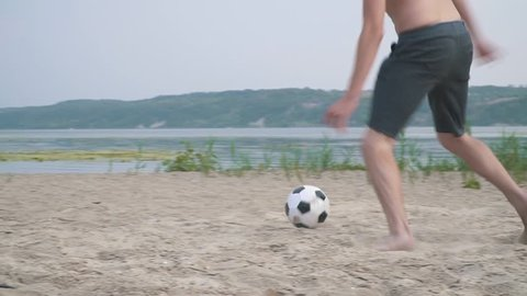 Two bare-chested men playing football Competition between people