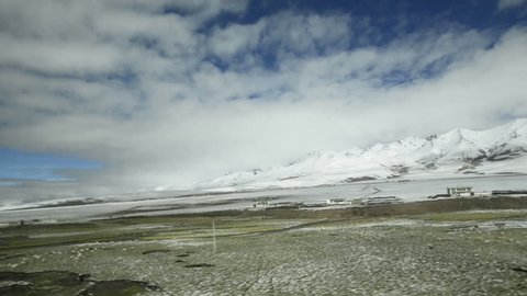 View through window of Qinghai–Tibet railway between Xining, Qinghai Province and Lhasa, Tibet Autonomous Region. The line leads up to 5.072 m (Tanggula Pass) and is the the world highest railway.