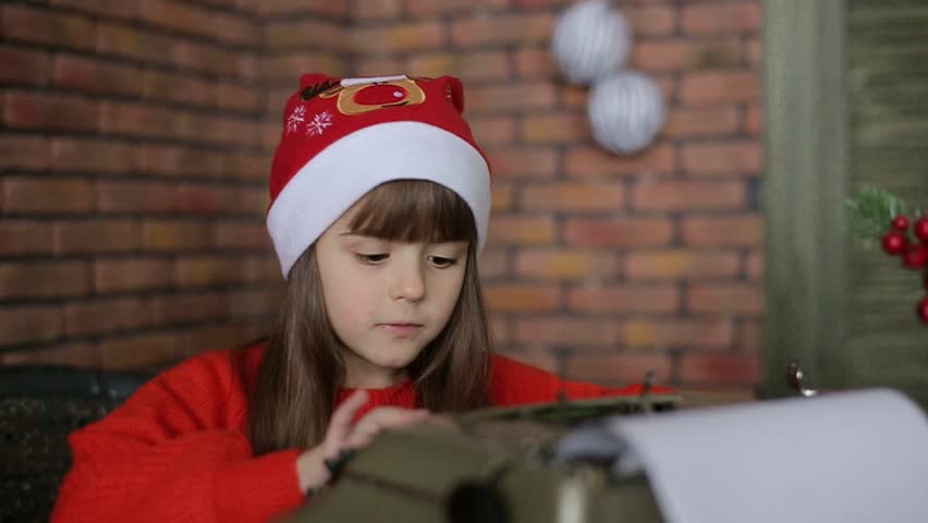 Little girl writes letter to Santa Claus | Shutterstock HD Video #1020285532