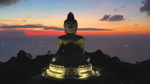 aerial view Phuket big Buddha in sunset.Phuket Big Buddha is one of the island most important and revered landmark on Phuket island location is on the high mountain can see view around Phuket island