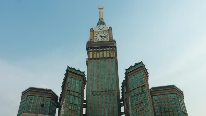 "Mecca clock tower - Timelapse at sunset Arabic script reading: ""Allah is great"" 