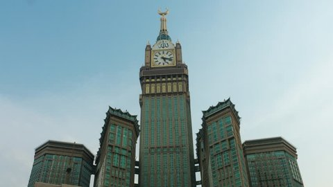 "Mecca clock tower - Timelapse at sunset Arabic script reading: ""Allah is great"""