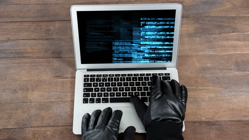 Digital animation of hackers hands on the laptop keyboard. Digital technology codes on the laptop screen  | Shutterstock HD Video #1020401032