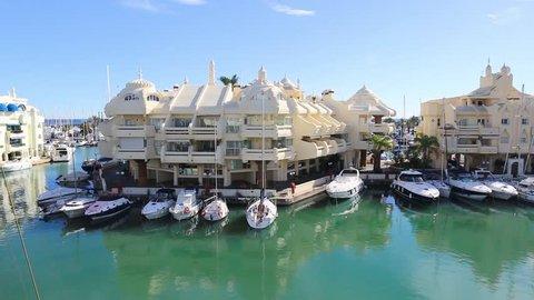 Puerto Marina in Benalmadena , Malaga, Spain - Beautiful Spanish Harbour , residential area and luxury boats .