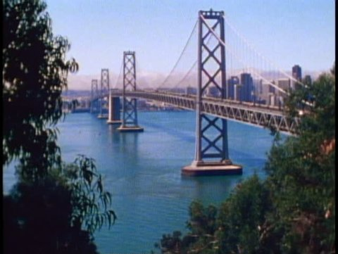 SAN FRANCISCO, CALIFORNIA, 1979, The Bay Bridge, framed in trees, skyline