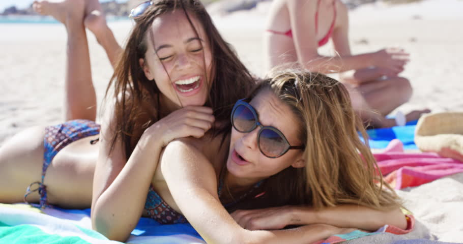 Close up portrait of teenage girl friends hugging each other on vacation #10205702