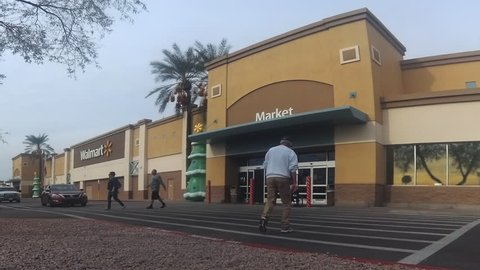 Scottsdale, Az, USA - Dec4, 2018: Motion of Walmart store building exterior during holiday season.  Walmart is the world's largest public corporation and the largest retailer in the world.