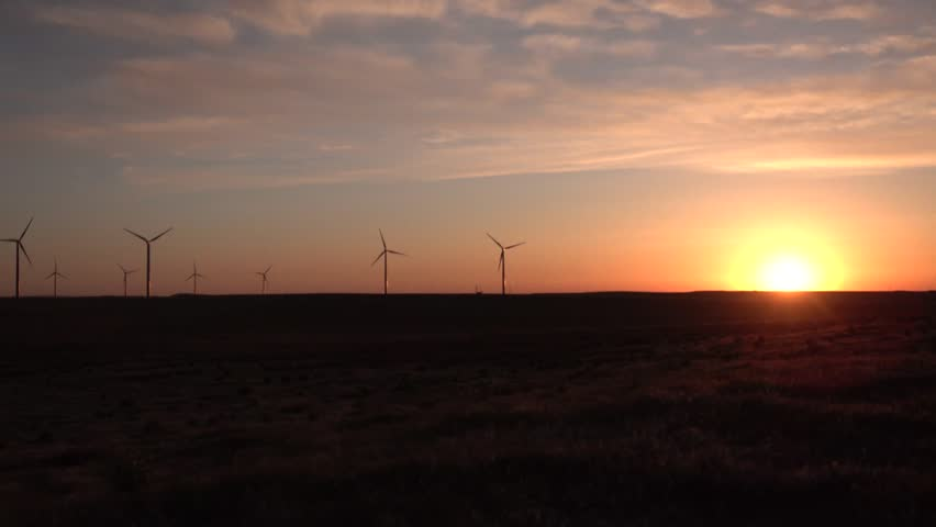 Scenic view of wind turbines power generator, Wind turbines at sunset in the state of Idaho, USA #1020616822