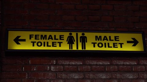 Yellow Public Toilet Sign