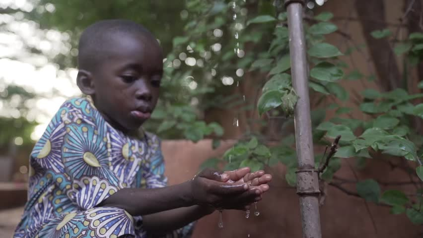 African Boy Cleans Hands with Clean Fresh Water in Bamako, Mali (HD Slow Motion)