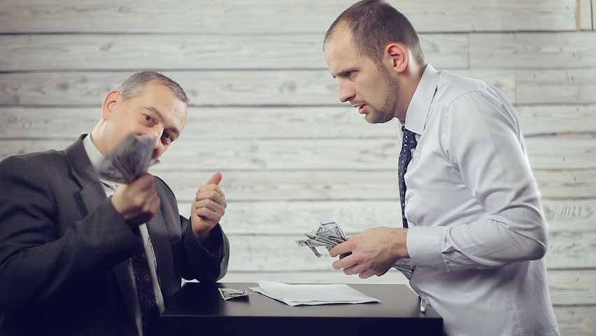 Two businessmen share profit   Shutterstock HD Video #1020728062
