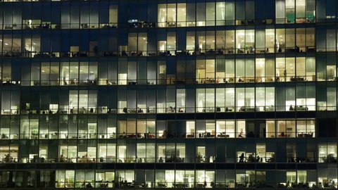 Timelapse of a huge corporate office building at night
