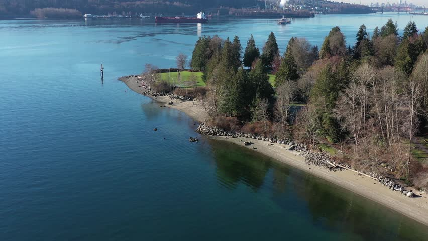 Aerial view over Burrard Inlet, ocean and island with boat and mountains in beautiful British Columbia. Canada. | Shutterstock HD Video #1020790432