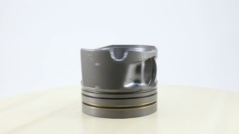 Piston. Piston group. This part of the car engine. footage rotating