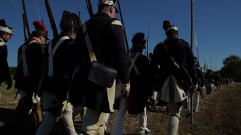VIRGINIA - OCTOBER 2018 - Reenactment, large-scale, epic American Revolutionary War anniversary recreation -- U.S. Continental Army Soldiers in formation marching as if on parade with Muskets, flags.