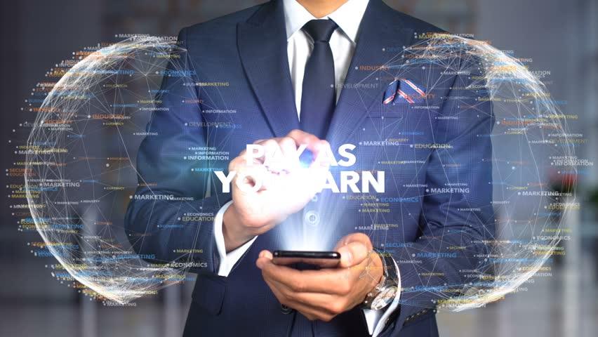 Businessman Hologram Concept Tech - PAY AS YOU EARN   Shutterstock HD Video #1020894712