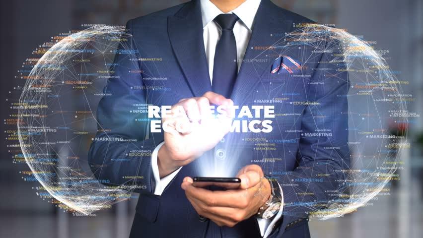 Businessman Hologram Concept Economics - Real estate economics   Shutterstock HD Video #1020894922