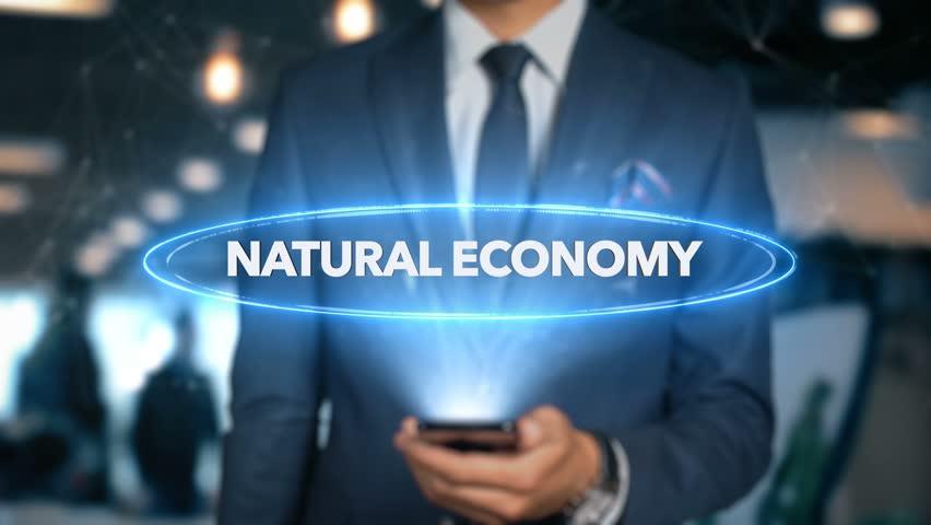Businessman Hologram Economics -Natural economy | Shutterstock HD Video #1020899182