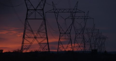Transmission Tower / Power Tower at Twilight with Rich Desert Storm Clouds