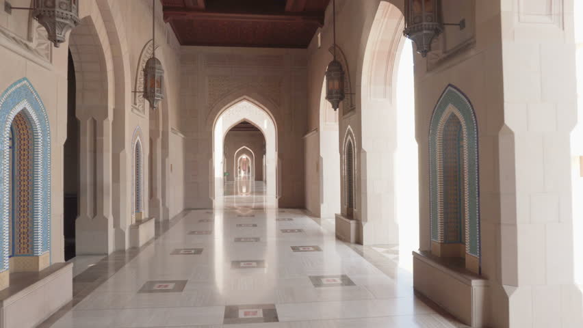 Beautiful arched passageway at the Sultan Qaboos Grand Mosque in Muscat, Oman. Wonderful interior of the Muslim place. Amazing Islamic architecture. | Shutterstock HD Video #1020907492