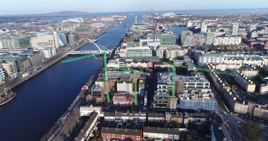 The drone flies over the river liffey, with the dublin skyline and flying towards the dublin port.  | Shutterstock HD Video #1020938722