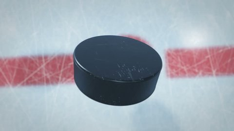 Close-up Hockey Puck Drop in Face-off Zone. 3d animation of Hockey-puck Falling on Ice with and without DOF Blur on Green Screen Alpha Mask. Active Sport Concept. 4k UHD 3840x2160.