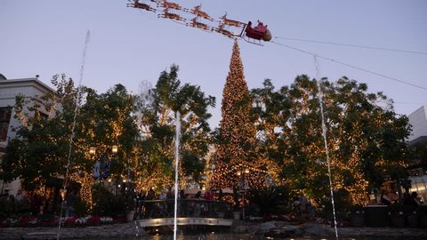 LOS ANGELES - Circa December, 2018 - An evening slow motion view of The Grove shopping and entertainment complex decorated for Christmas.