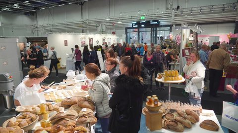 Stockholm sweden 2018 october 17: the people inside the baking competition  building in stockholm sweden with lots of breads on display