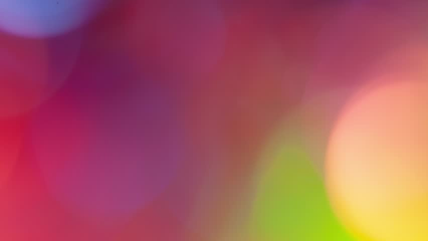 Abstract background with a colorful dynamic leaks. Glowing dots on dark background. | Shutterstock HD Video #1021261252