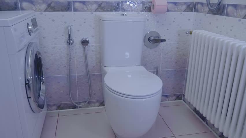Radiator Voor Toilet : Bathroom interior washing machine radiator stock footage video