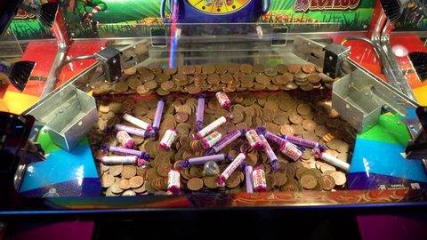Edinburgh, united kingdom (uk) - 09 01 2018: edinburgh, uk - circa  september 2018: coin pusher game machine slowly pushing coins of the edge