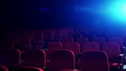 Cinema Theater With Comfortable Red Chairs. Empty Cinema Seats in Dark Theatre for Movies. Seamless Loop.