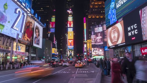 NEW YORK CITY, USA - NOVEMBER 20, 2018: Cars Traffic and People Crowd at Times Square at Night. Vertical Panoramic Time Lapse