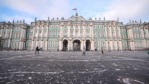 St. Petersburg, Russia. People passing by Hermitage museum. Winter.