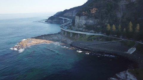 4K Sunset Car Chase Drone Footage at Sea Cliff Bridge Nsw Australia